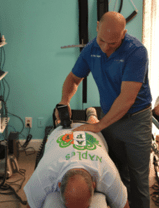 Dr. Neil Koppel doing chiropractic adjustment