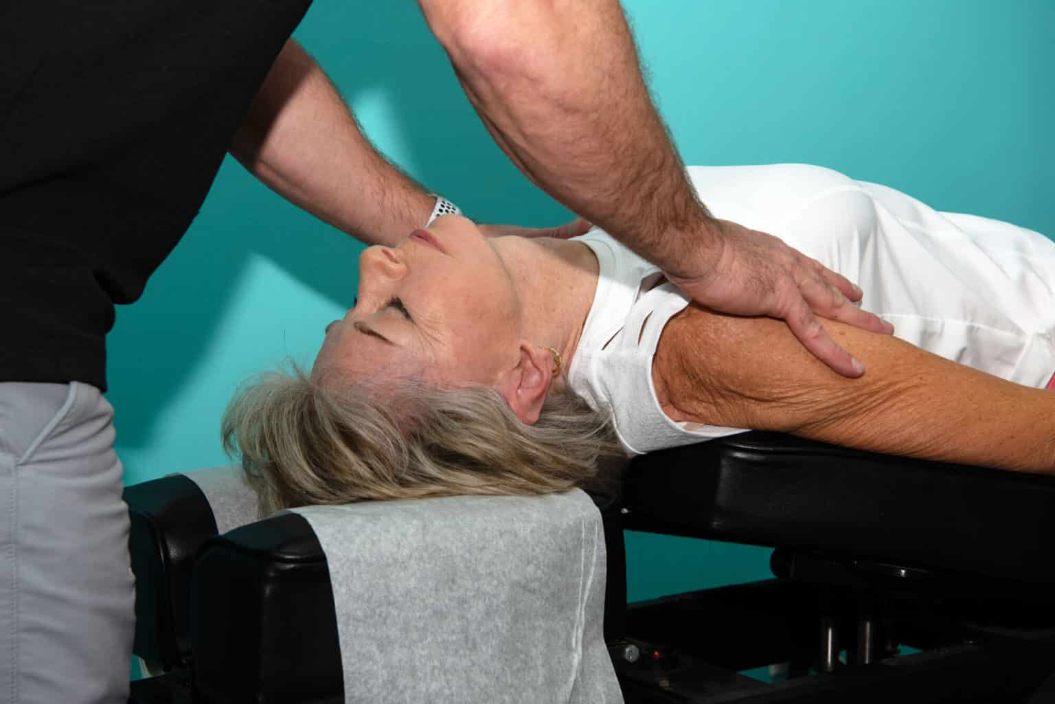 Dr. Neil doing an chiropractic adjustment to a adult patient